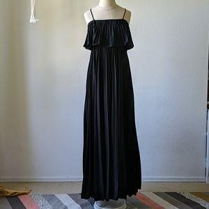 Vintage 1970s acordeon black deadstock maxi dress